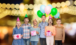 happy children with gifts at birthday party