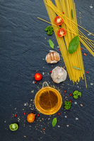 Italian food concept. Spaghetti with ingredients sweet basil ,tomato ,garlic peppercorn ,champignon,zucchini and parmesan cheese on dark background flat lay and copy space.