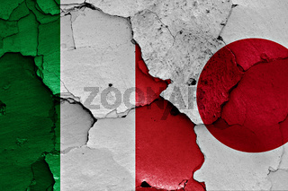 flags of Italy and Japan painted on cracked wall