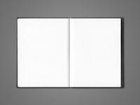 Blank open notebook isolated on dark grey
