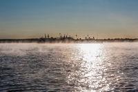 River landscape with fog during sunrise