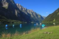 Lake Klontalersee and mountains in Summer. Beautiful travel destination in Switzerland.