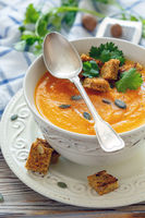 Spicy pumpkin soup in a porcelain bowl.