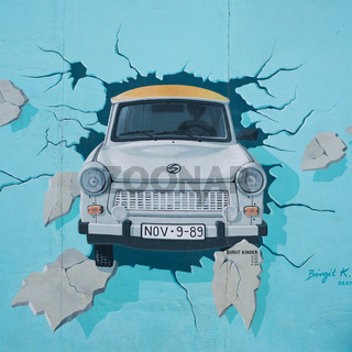 Mural of Trabant car breaking through the Berlin Wall at East Side Gallery