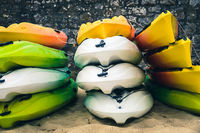 Stacked kayaks on a beach
