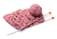 Knitting with needles and yarn ball