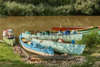 Canoes on the Riverside