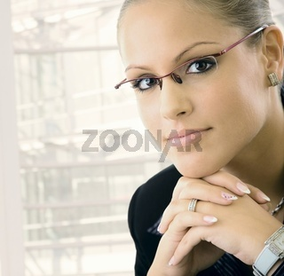 Young businesswoman thinking