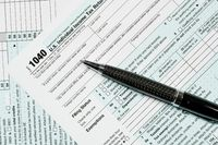 Pen laying on 2017 IRS form 1040