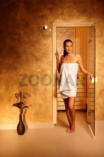Young woman leaving sauna