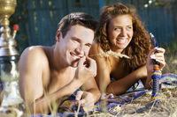 Young couple smoking hookah