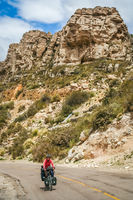 Woman cycling on the famous Ruta Quarenta