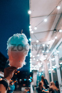 hand holding cotton candy