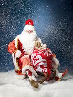 Santa flying his sleigh against snow