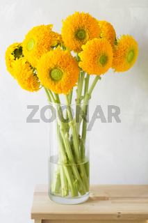 Bouquet of sunflowers and wild flowers on wooden table, copy space