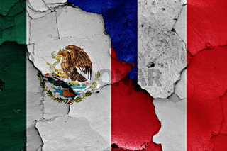 flags of Mexico and France painted on cracked wall
