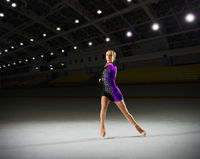 Young woman figure skater at sports hall