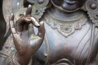 Detail of Buddha statue with Karana mudra hand position