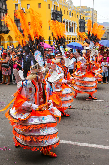 Local men dancing during Festival of the Virgin de la Candelaria in Lima, Peru