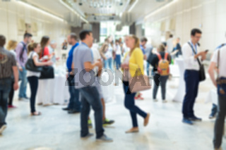 Blured image of businesspeople at coffee break at conference meeting.