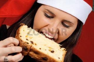 Santa Claus girl eating panettone