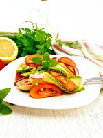 Salad with zucchini and tomato on board