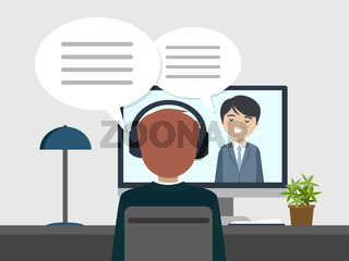 Two people talking by videoconference