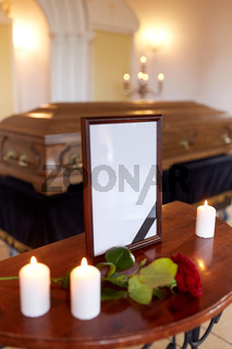 photo frame and coffin at funeral in church