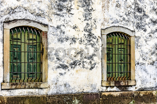 Old wooden church windows with stone frame