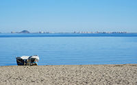 Empty beach of Los Alcazares and view to the La Manga del Mar Menor seaside spit, Spain.