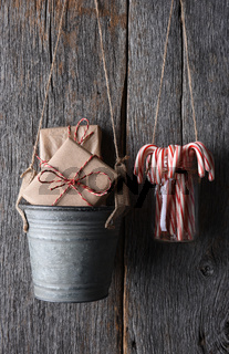Presents and Candy Canes Hanging on Rustic Wall