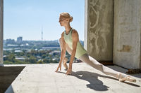 Ballerina posing at unfinished building