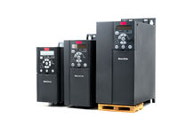 A group of three different sizes and capacities new universal inverter for controlling the electric current and power for industrial on a isolated white background. A frequency converter - rectifier - power stabilizer