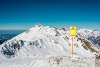 Off-piste sign. Winter mountain landscape. Krasnaya Polyana, Sochi, Russia