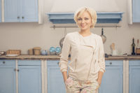 Blond lady posing in kitchen