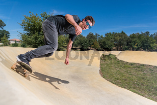 Skateboarder on a pump track park