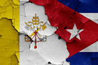 flag of Vatican and Cuba painted on cracked wall