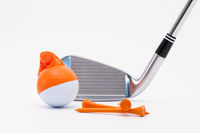 White golf ball with funny cap and golf club on the white background.