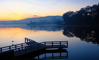 small bridge reflect on lake at sunrise