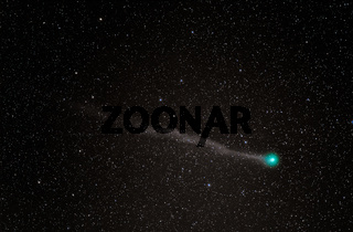 Comet Lovejoy with a green head and long tail