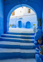 Arches and doors in blue city Chefchaouen