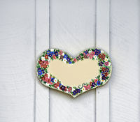 Wooden heart with painted flowersr