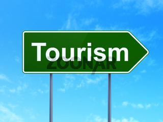 Travel concept: Tourism on road sign background