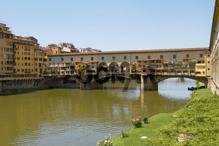 FLORENCE, ITALY - JUNE 5, 2010: Tourists Enjoying Vacation at Ponte Vecchio in Florence Italy
