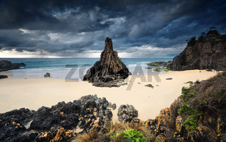 Moody storm clouds loom over Pyramid sea stack