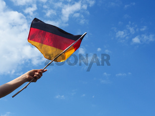 Female hand with the German flag
