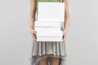 Girl with white boxes