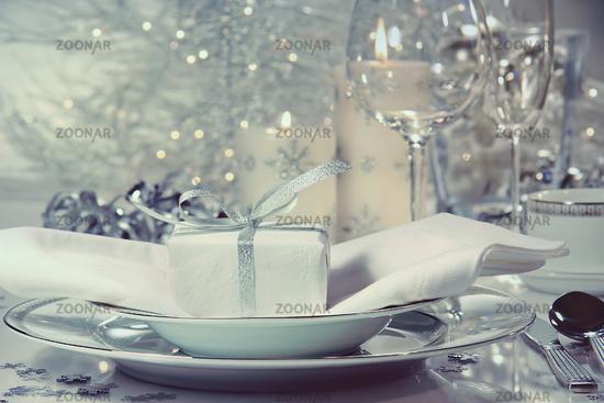 Festive dinner setting with gift