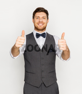 happy man in festive suit showing thumbs up