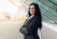 Beautiful young and confidents business woman in urban setting